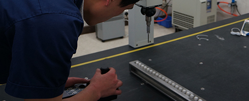 ASMPT's production staff using a CMM