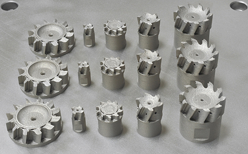Multiple AM cutter parts produced on a single build plate. Credit: KOMET GROUP